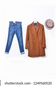 brown long coat with blue jeans ag, hat on white background