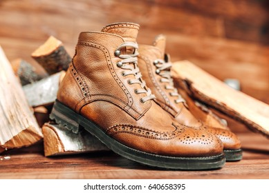 Brown  male shoes on background block tree. Gentlemen's style. Wooden background