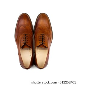 Brown male shoes on a white background