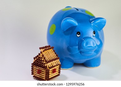Brown matchhouse with blue piggy bank