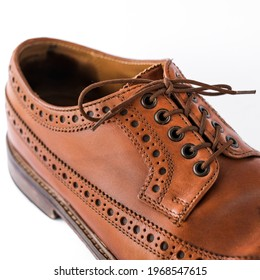 brown men's brogues on a white background close-up. classic men's shoes. mockup