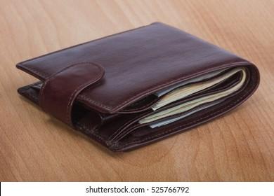 brown men's wallet with money