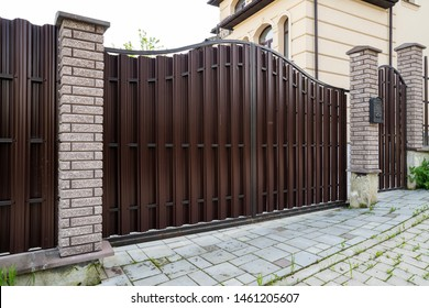 brown metal gate with a wicket