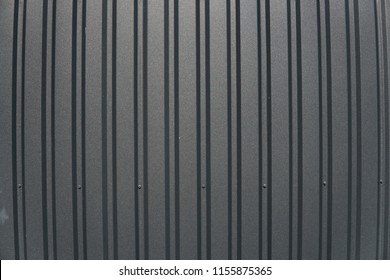 Brown metal plate. Siding. Seamless surface of galvanized steel. Industrial building wall made of corrugated metal sheet, flat background photo texture.