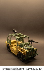 Brown military toy car model with background and copy space