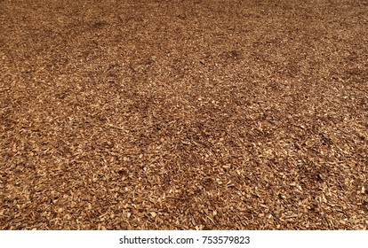 Brown mulch outdoors.