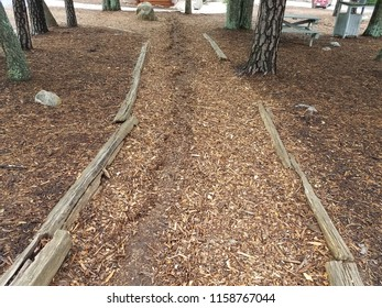 brown mulch or wood chip path with erosion