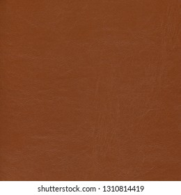Brown natural leather textured background. Vintage fashion background for designers and composing collages. Luxury textured genuine leather of high quality.