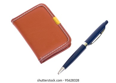 Brown notebook  and a blue pen. Isolated on white background, clipping path