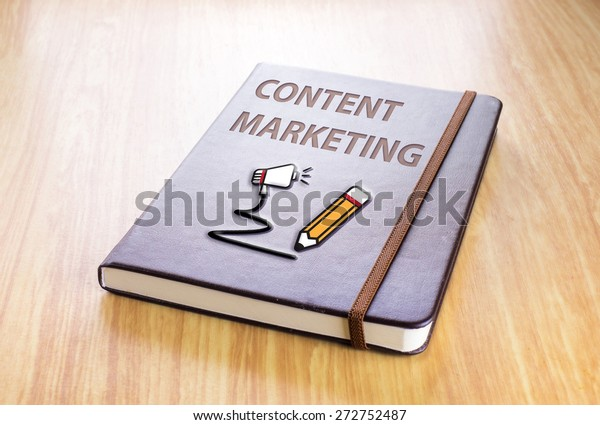 Brown notebook with Content marketing word and pencil with speaker icon on wood table, Technology concept
