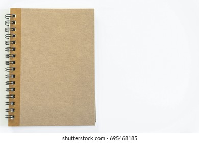 A brown notebook placed on the office desk.