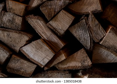 Brown old chopped firewood wall. Textured background  with wooden natural panel. Chopped firewood vintage material for decoration.