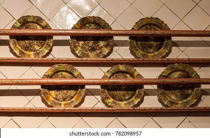 Brown old plates hanging on a wall