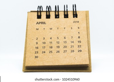 Brown old vintage desk calendar of April of 2018 isolated on white background