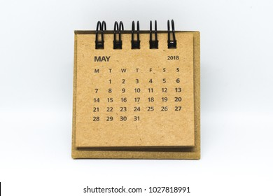 Brown old vintage desk calendar of May of 2018 isolated on white background