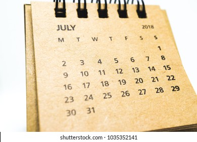 Brown, old, vintage desk calendar of July 2018 isolated on white background
