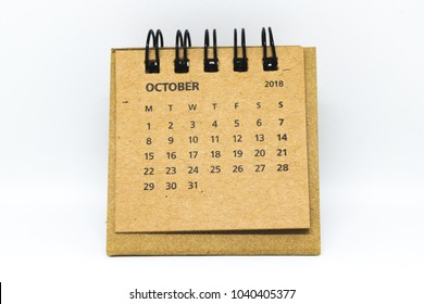 Brown, old, vintage desk calendar of October 2018 isolated on white background