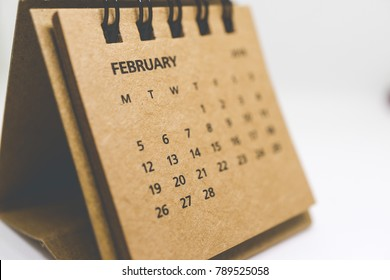 Brown old vintage desk calendar of February of 2018 isolated on white background