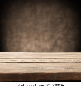 brown old wall background and wooden desk space and free space for you
