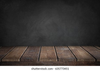 brown old wood desk and black wall background