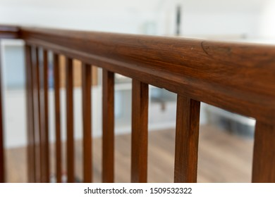 Brown old wood railing in a newly renovated house