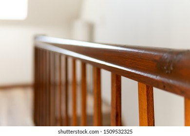 Brown old wood railing in a newly renovated house. Light and sunshine