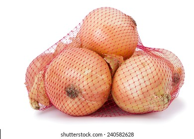 Brown onion in packed in a red net bag.