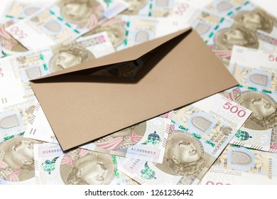 Brown opened envelope on 500 PLN banknotes background