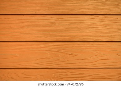 Brown or orange wood texture and background, Wood substitute board and high quality fiber cement board texture for architect, Wood plank with patterns for design and cement striped wood wall