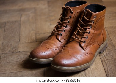 brown oxford classic leather waxed fine stylish elegant male shoes on wooden floor