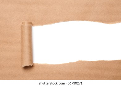 Brown package paper torn to reveal white panel ideal for copy space