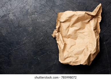 Brown packaging paper on black background