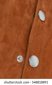 Brown painted natural soft leather with metal snap buttons, one opened