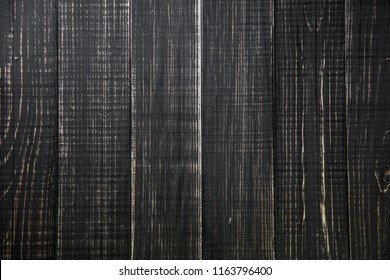 Brown painted pine wooden planks background. Flatlay top view horizontal color photography.