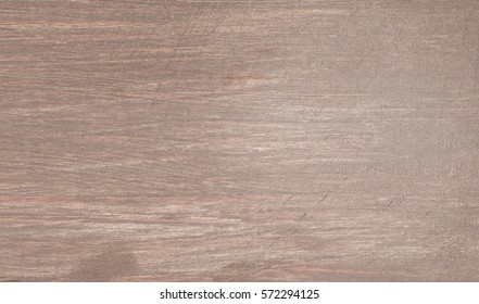 Brown painted, scratched wood texture with natural pattern. Table, floor or fence surface
