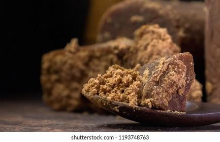 Brown palm sugar on wooden board