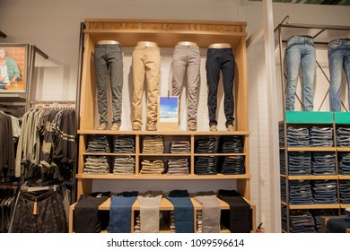 Brown Pants On The Store Shelf. Brown Pants Collection Pants Stacked.