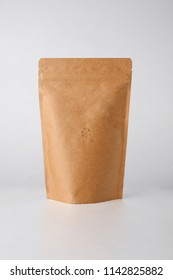 brown paper bag with coffee beans