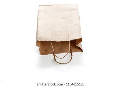 Brown paper bag on white background. close up shot