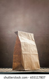 Brown paper bag with still life on rusty background