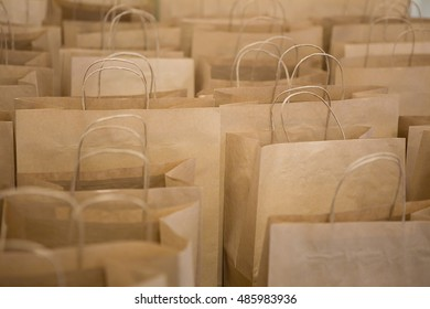 Brown paper bags in rows