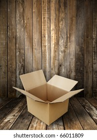 Brown paper box open in Grunge wooden panel and floor room background