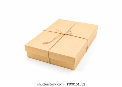 Brown paper box, tied with string on white background.