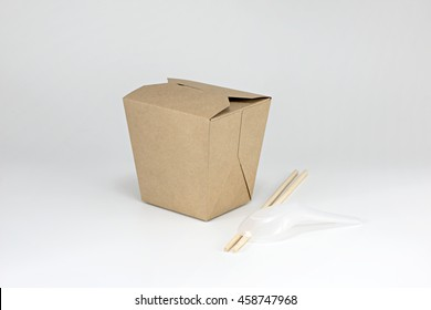 Brown paper cardboard food container with chopsticks and plastic spoon