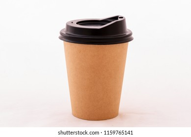 Brown paper coffee cup and black cover on white background.Disposable and recycle cup.