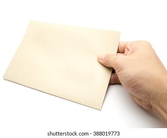 Brown paper in a hand with bank space on white background.
