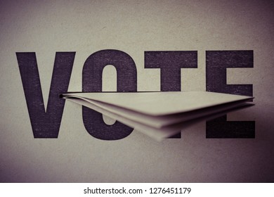 brown paper insert in vote box, selective focus, retro tone, democracy concept