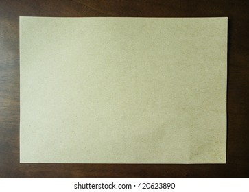 Brown paper on wood texture