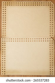 brown paper on a wooden background