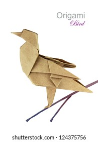 Brown paper origami bird on a branch